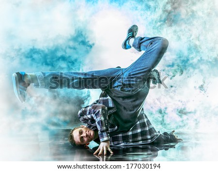 Modern young man dancer dancing at studio. - stock photo