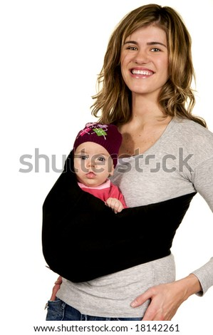 Modern young mother carrying her baby in a sling