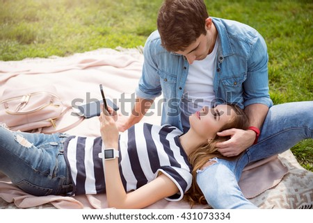 Modern young people in a park - stock photo