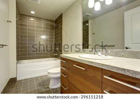 Modernized bathroom with great bathtub and tile flooring. - stock photo