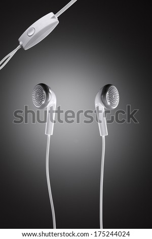 Modernly designed white headphones against circle gradient - stock photo