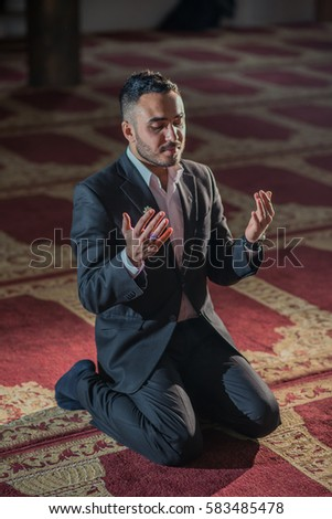 stock-photo-modest-business-man-praying-to-allah-583485478.jpg