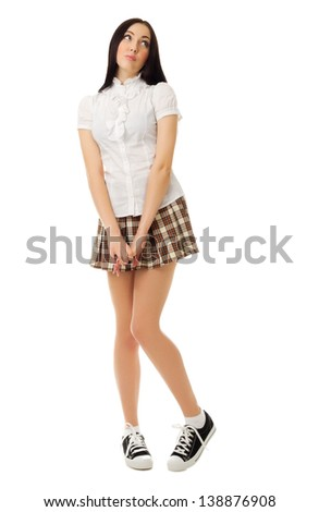 Modest teen girl with backpack isolated on white