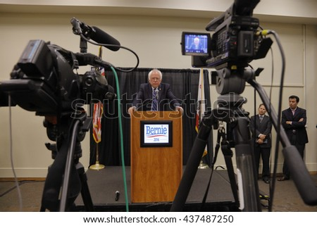 MODESTO, CA- JUNE 02, 2016: Presidential candidate, Bernie Sanders framed by TV cameras hosts a press conference prior to a rally at Modesto Centre Plaza in Modesto, CA.