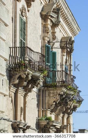 Modica baroque balcony, Modica, Ragusa, Sicily, Italy, Europe - stock photo