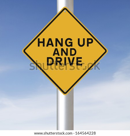 Modified road warning sign on the use of mobile phones while driving  - stock photo