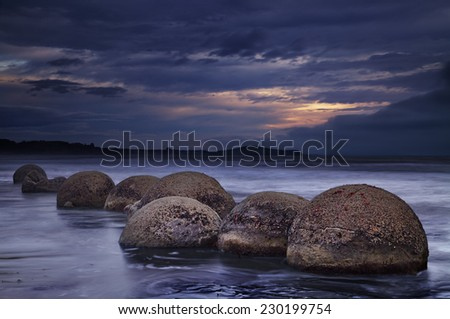 Moeraki Boulders at sunrise, South Island, New Zealand  - stock photo