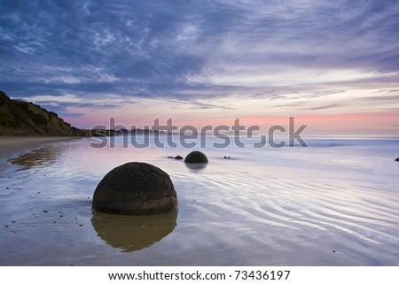 Moeraki Boulders at Sunrise South Island New Zealand - stock photo
