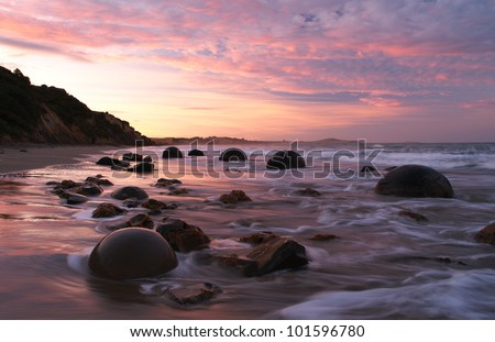 Moeraki boulders during sunset, Moeraki, New Zealand - stock photo