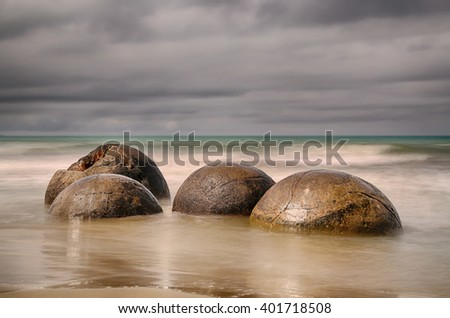 Moeraki Boulders near Dunedin, New Zealand - long time exposure - stock photo