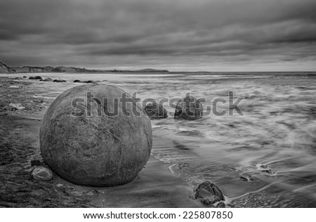 Moeraki Boulders on the Koekohe beach, Eastern coast of New Zealand. HDR image, black and white - stock photo