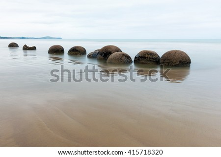 Moeraki Boulders on the Koekohe beach, Eastern coast of South island, New Zealand