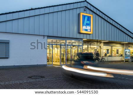 MOERS / GERMANY  - DECEMBER,  10. 2016 Traffic on a chain Store during dusk.