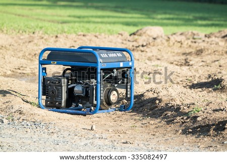 MOERS / GERMANY - NOVEMBER 03 2015 : Portable diesel power generator standing in a field and producing power