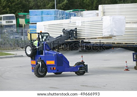 moffett telemount forklift in operation loading a truck - stock photo