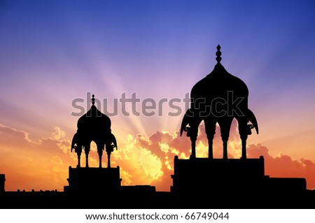 Mogul style pavilions silhouettes at sunset of a Maharajah palace in Bikaner, Rajasthan, India.