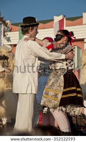 MOHACS, HUNGARY - FEBRUARY 15, 2015: Unidentified people in mask participants at the Mohacsi Busojaras, a carnival for spring greetings on February 15, 2015 in Mohacs, Hungary.