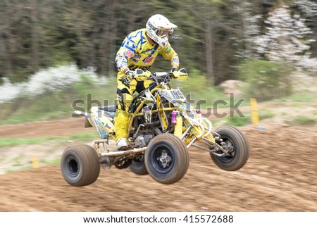 "MOHELNICE, CZECH REPUBLIC - APRIL 23. Closeup dynamic shot of quad rider in the ""Crossracing cup 2016- Quad Championship of Czech Republic"" on April 23. 2016 in Mohelnice. - stock photo"