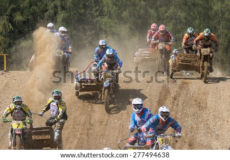 "MOHELNICE, CZECH REPUBLIC - APRIL 25. Group of racers is skipping the horizon in the ""International Championship of Czech Republic in sidecarcross 2015"" on April 25. 2015 in Mohelnice. - stock photo"