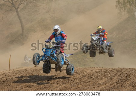 "MOHELNICE, CZECH REPUBLIC - APRIL 25. Two quad riders in a jump in the ""International Championship of Czech Republic in Quad 2015"" on April 25. 2015 in Mohelnice. - stock photo"