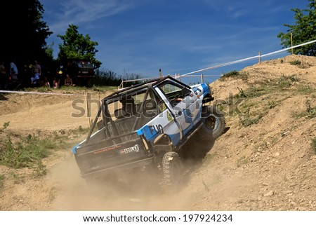 "MOHELNICE,  CZECH REPUBLIC - JUNE 07: Off-road car is hitting a steep hill in the ""Championship of the Czech Republic in the off road tech trial-2014"" on June 07, 2014  in MOHELNICE, Czech Republic."