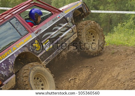 "MOHELNICE, CZECH REPUBLIC - JUNE 10. Unidentified racer at off-road car leaves steep slope in the ""SHOCK CUP Trial 2012"" on June 10, 2012 in the town of Mohelnice, Czech Republic."