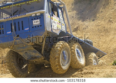 "MOHELNICE, CZECH REPUBLIC - MAY 20. Unidentified racer at blue truck  passes through difficult terrain in the ""Grand Prix Truck Trial 2012"" on May 20, 2012 in the town of Mohelnice, Czech Republic."