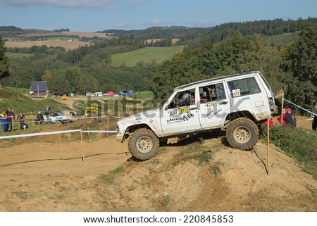 MOHELNICE,  CZECH REPUBLIC - SEPT 28: White off road car is hitting a steep hill in the BIG SHOCK! CUP of the Czech Republic. On September 28, 2014  in MOHELNICE, Czech Republic.