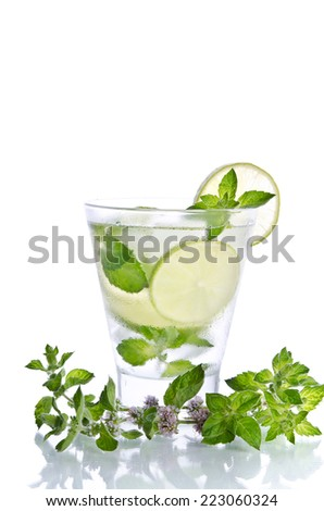 Mohito mojito drink with ice mint and lime on white background - stock photo