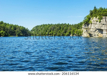 Mohonk lake, nestled in the Shawangunk Mountains and surrounded by dense forests and nature in New Paltz, New York. - stock photo