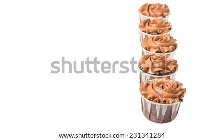 Moist chocolate cupcake over white background - stock photo