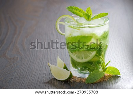 mojito cocktail and ingredients on a wooden table, horizontal - stock photo