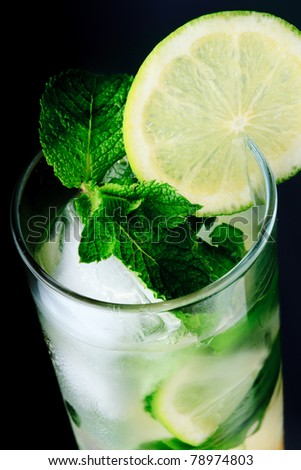 Mojito cocktail close up on black background - stock photo