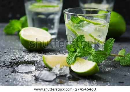 Mojito cocktail in a bur on a rustic table, selective focus - stock photo