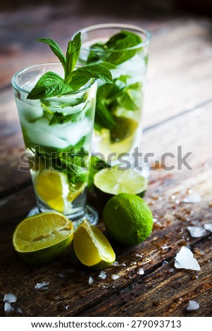 Mojito cocktail in a bur on a rustic table, selective focus