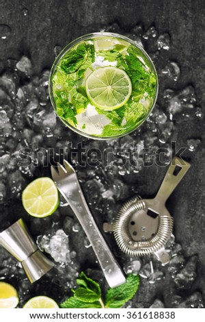 Mojito cocktail ingredients lime, mint, ice. Drink making tools. Top view - stock photo
