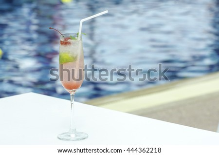 Mojito cocktail  on a swimming pool, cherry