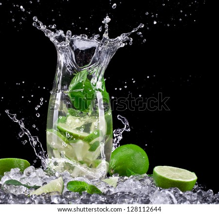 Mojito cocktail on black background - stock photo
