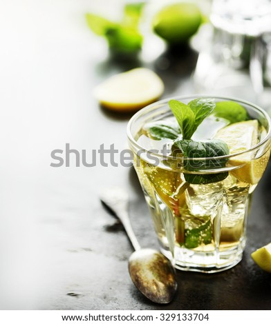 Mojito cocktail on dark table with copyspace.