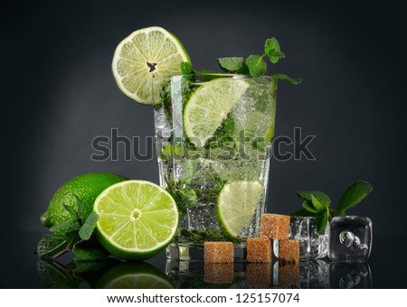 Mojito cocktail over black background - stock photo