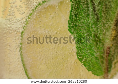 Mojito cocktail with fresh lime on wood  table - stock photo