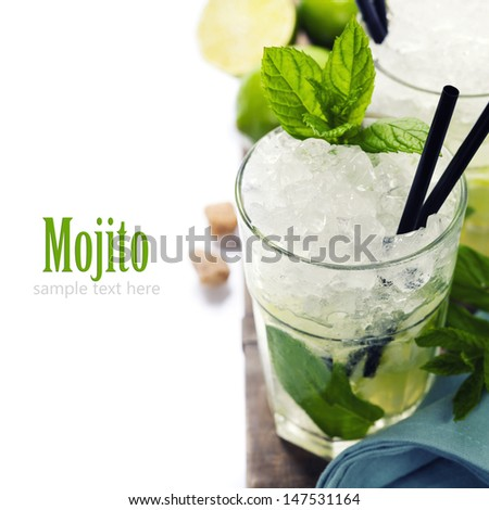 Mojito cocktail with ingredients on wooden background (with sample text) - stock photo