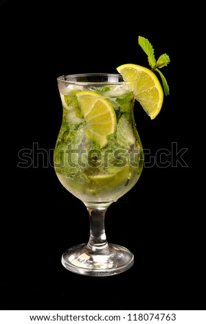 Mojito cocktail with lime on a black