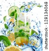 Mojito Cocktail with splashing liquid isolated on white - stock photo
