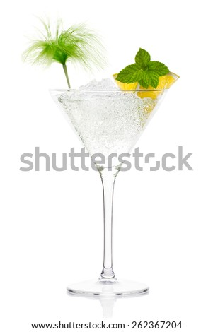 Mojito cocktail with vodka garnished with lemon and mint in a tall stemmed conical martini glass with ice conceptual of a tropical vacation, nightclub or celebration over a white background - stock photo