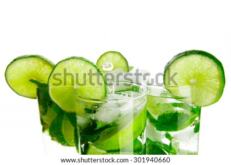 Mojito cocktails with lime and mint isolated on white background - stock photo