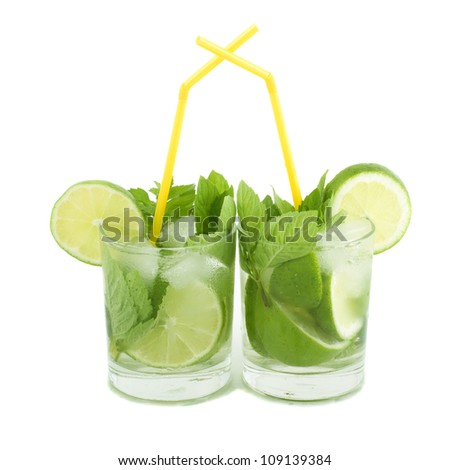 Mojito cocktails with mint leaf and lime slices isolated on white background - stock photo