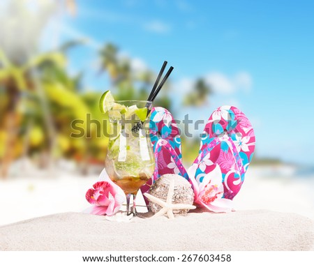 Mojito drink,  flip-flops with tropical beach background, summer accessories - stock photo