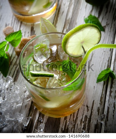 Mojito drink on vintage wooden background - stock photo