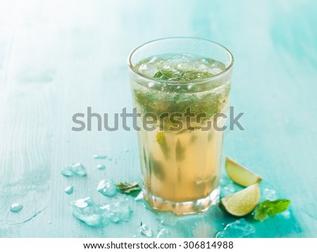 Mojito drink or lemonade with lime and mint, selective focus